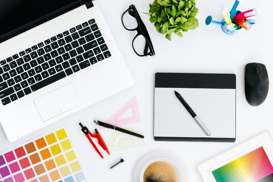 graphic design tools on a desk
