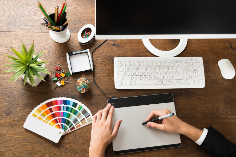 desk full of creative and artistic tools