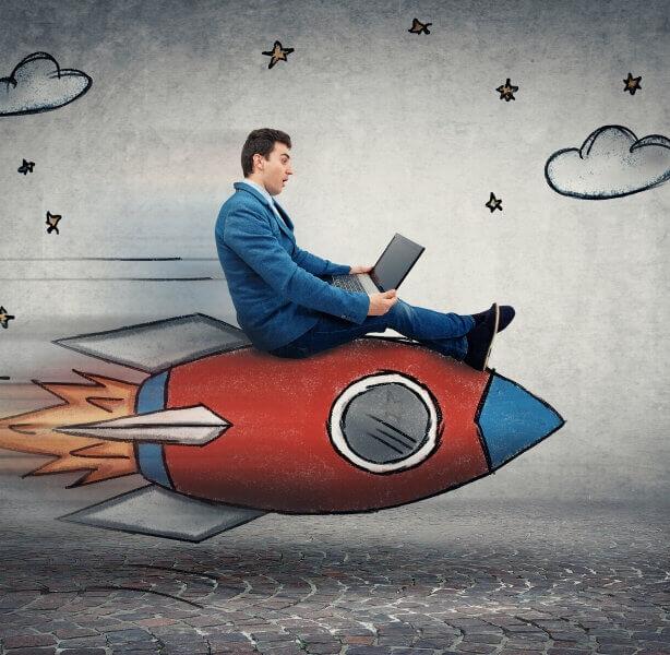 man sat on rocket to success