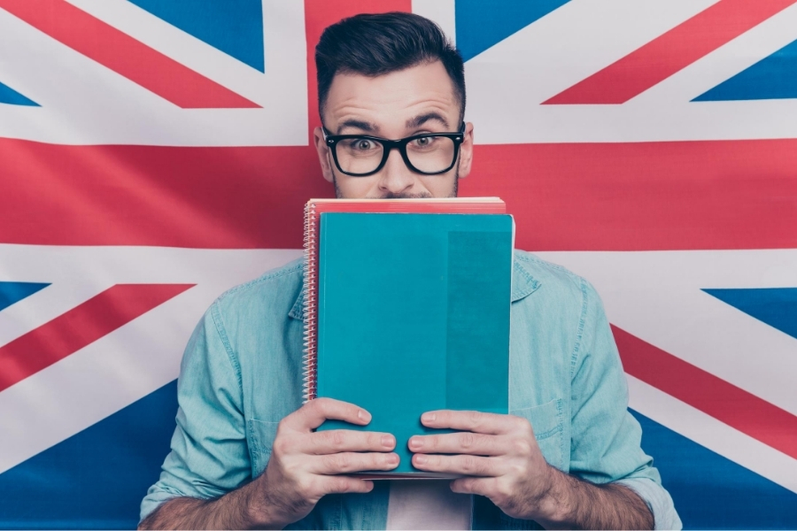 man in front of union jack teaching english online for money